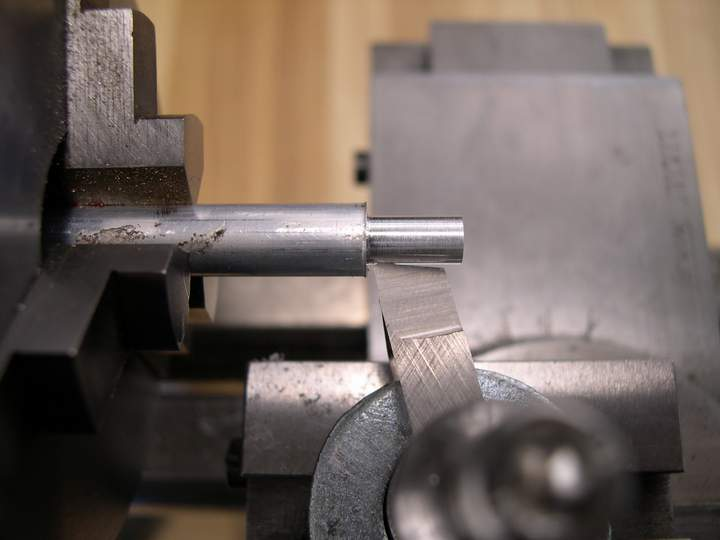 Turning a part on a lathe cross slide.